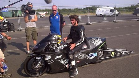 Litlington's Ian King (in blue) with Guy Martin