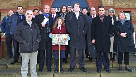 Barristers on strike stand on the steps of St Albans Crown Court