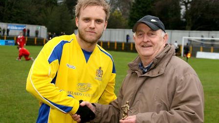 Richard Graham received the Player of the Month award from Bill Toyer on behalf of Bennetts Motor Fa