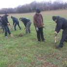 Volunteers from Ahmadiyya Muslim Youth Association plant trees at Heartwood Forest