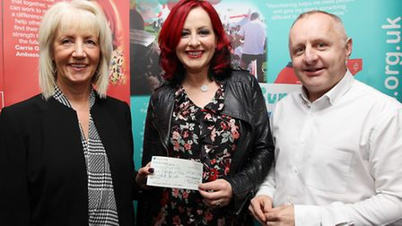 Fundraiser Anne Swanston presents a cheque for £5,300 to Crohn's and Colitis UK Ambassador Carrie Gr