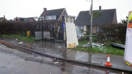 The bus shelter after it was hit by a shed.