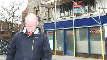 Cllr Brian Ellis stands outside the old Isis store which is being refurbished