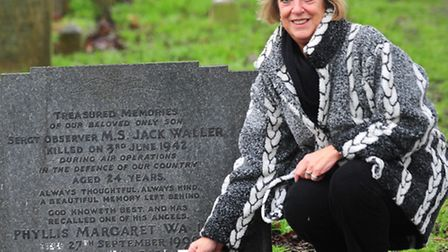 """Paula Masters of Radlett at the grave ofSgt Maurice """"Jack"""" Waller who was in the RAF and was shot do"""