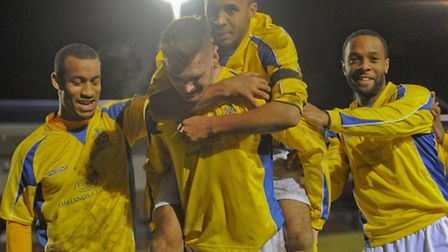 James Kaloczi, centre, is mobbed by his team-mates after scoring the winning goal against Burnham. P