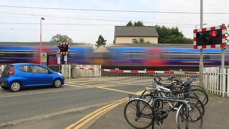 A lorry has crashed into the barriers at Foxton level crossing