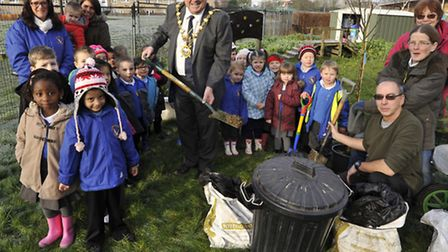 Reception pupils at St Johns School, Huntingdon, help Mayor Bill Hensley plant a tree, from the Oxmo