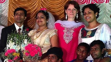 Rachael Tomkins, second back right, who is stuck in India after a visa glitch, has been teaching at