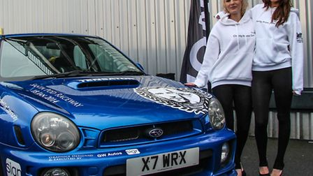 Promotion girls Torria Murray (left) and Lauren Morgan with Greg Moore's car at Santa Pod. Picture b
