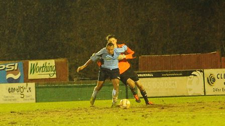 James Comley is pulled down by Hemel goalkeeper Jack Smith, who received a yellow card for the foul.