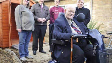 Eaton Socon veteran Graham Frost (front), received an electric wheelchair from the charity SSAFA. (F