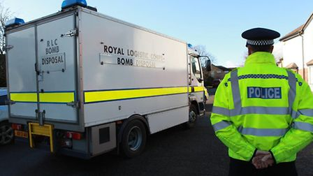 A bomb disposal unit van and a police officer in Beverley Gardens where the potentially explosive de