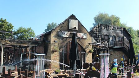 The charred remains of the Hartford Mill pub