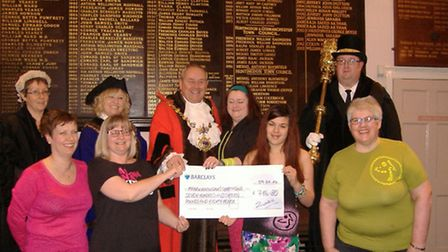 Mayor of Huntingdon Councillor Bill Hensley was presented with a cheque for £716.80, the proceeds of