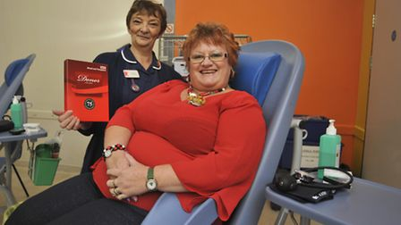 Lesley Hart who is giving her 75th pint of blood, at Eynesbury Methodist Church Hall, with Donor Car