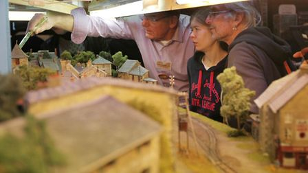One of the exhibitors at the model railway exhibition talks to interested visitors about his work