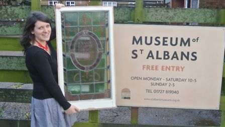 Catherine Newley, curator at the Museum of St Albans, with one of the memorial windows