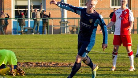 Lewis Hilliard scores St Neots' opener in their game against Poole Town. Picture: Claire Howes