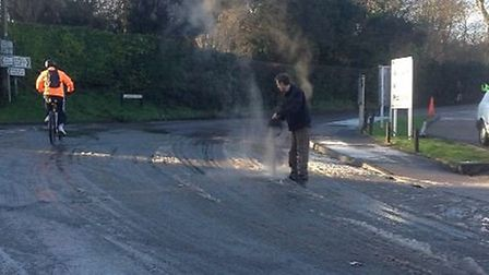 The Fox and Hounds landlord Adrian Parkes puts ash down at the junction in Barley. Credit: Nick Whit