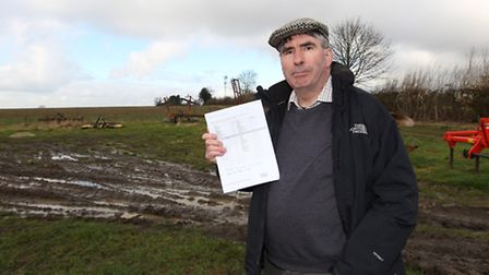 Farmer Howard Roberts stands in the field where he carried ot The Big Farmland Bird Count on Hammond