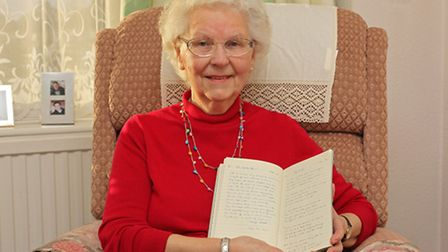 Rosemary Webb, 84, with her book of poems including a poem about her battle with breast cancer
