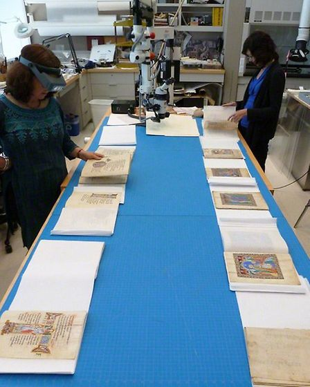 Nancy Turner and Kristen Collins with the St. Albans Psalter in the Getty conservation lab. Photo co