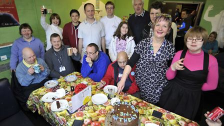 The Dreamers Bar, at Huntingdon Youth Centre, celebrate its 3rd Birthday, users cutting the cake wit