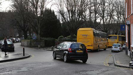 School buses arriving to take children of St Albans School away cause a traffic jam on Romeland Hill
