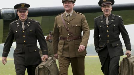 (l to r) Matt Damon, Hugh Bonneville and George Clooney in Columbia Pictures' THE MONUMENTS MEN.