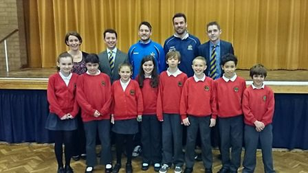 Bernards Heath Junior School welcomed St Albans City footballers.In the row behind pupils are, from