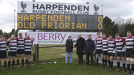 Peter Danby, Tony Berry and Ian Haddock unveil Harpenden RFC's new scoreboard in front of the first