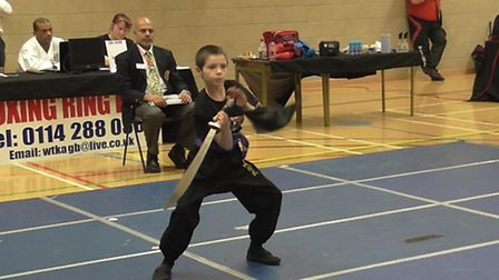 George Stanway does his Chinese broadsword routine.