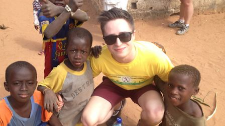 Isaac Brindley, pictured with youngsters in The Gambia.