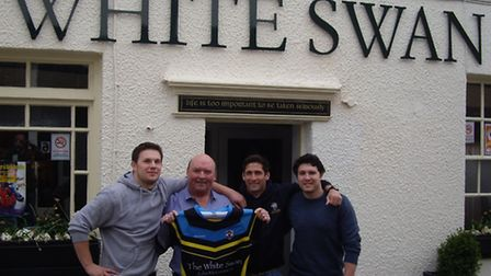John McGuinness pictured last year with Cents players Sam Norris, David Coyle and Gareth Walters aft