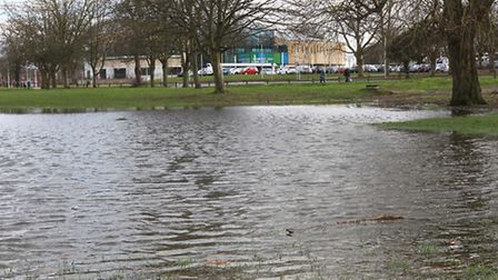 The flooded area of Westminster lodge with the leisure centre in the background