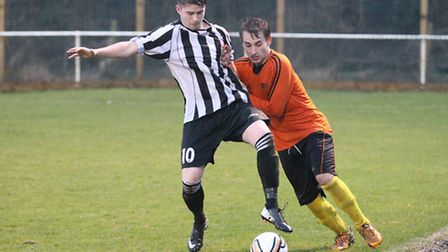 Elliot Bailey holds off a defender in his debut for London Colney. Picture: Danny Loo