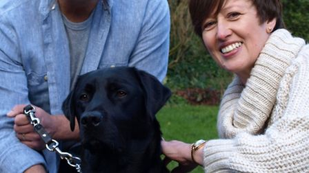 Lesley and Nick Gilbert of St Albans with Sidney, the eighth trainee guide dog the couple has boarde