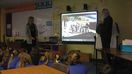Dr Hildegard Diemberger and Bruce Huett from Pembroke College talking with pupils from Steeple Morde