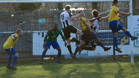 Jimmy Dean rises to head home St Ives' first goal in their 5-4 defeat to Northwood. Picture: Louis T