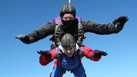 Julie Drewitt in action during her skydive to raise money for Blind Dog Rescue UK.