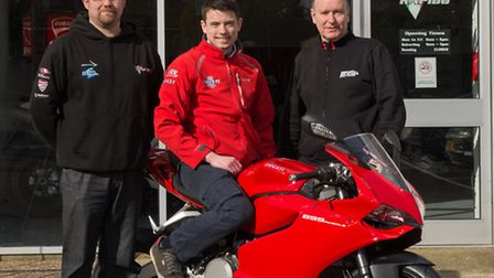 Steve Moore of Moto Rapido Ducati stands to the left of Jon Railton with Mike Green from Boast Plum