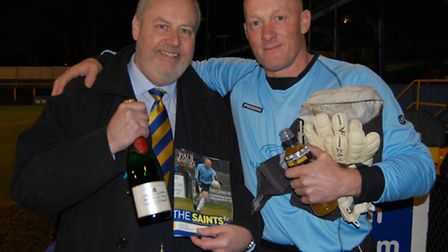 Paul Bastock is presented with a bottle of champagne by chairman Nick Archer ahead of his 300th appe
