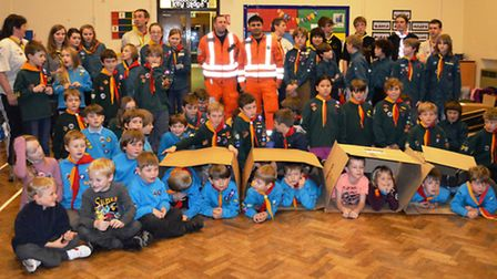 Camping under cardboard are members of 1st Earith, Bluntisham and Colne Scout Group, pictured with M