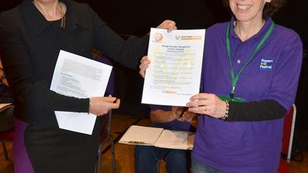 Denise Graham, of the Royston Volunteer Centre, presents the Six-point Promise certificate to Tina F