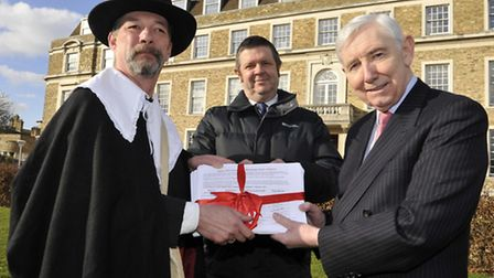 Bob Pugh of the Friends group hands over the petition to county council leader Councillor Martin Cur