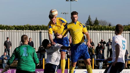 Ben Martin is unable to direct his header past Lee Crockett. Picture: Leigh Page