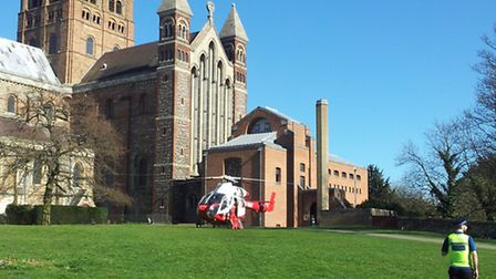 The air ambulance lands outside the Cathedral