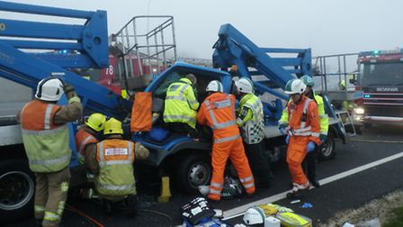 A lorry driver was freed from a cab following a crash near Black Cat roundabout.