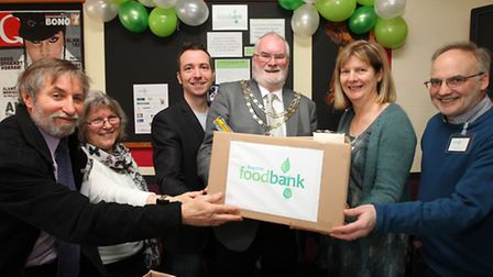 Mayor of Royston Cllr Robert Smith officially opens the Royston Foodbank with a donation accepted by