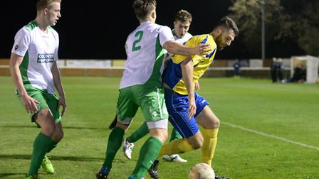 Tom Ward takes on three defenders. Picture: Bob Walkley